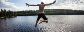 A person jumping into a lake