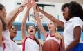 A girls basketball team giving each other high-fives
