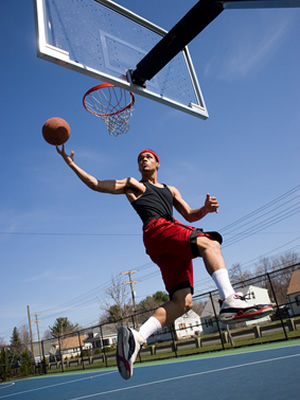 A man playing basketball after visiting shoulder specialist Dr. Matthew Warnock in Houston, TX