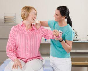 A professional massaging the shoulder of a patient